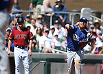 Los Angeles Dodgers&rsquo; Justin Turner makes a play during a spring training game in Scottsdale, Ariz., on Friday, March 18, 2016. <br />Photo by Cathleen Allison