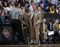 California head coach Mike Montgomery argues with the referee about a bad call during 2014 National Invitation Tournament against Arkansas at Haas Pavilion in Berkeley, California on March 24th, 2014.  California defeated Arkansas, 75-64.