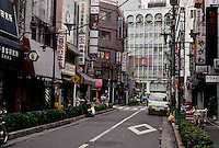Tokyo: Street in Ikebukuro. Narrow street but allowed for greenery and walkability. Photo '81.