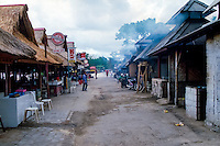 Bali, Badung, Jimbaran. The seafood is grilled over coconut husks, the smoke can be very irritating! The entrances is to the left where you can pick the food and bargain for a good price.
