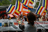 A Dalai Lama supporter points her finger to Shugden Community members and American tibetans as they take part in a protest regarding religious intolerance against their Buddhist community while the Dalai Lama visits New York. 07.09.2015. Eduardo MunozAlvarez/VIEWpress.