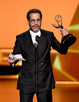 LOS ANGELES - SEPTEMBER 22: Tony Shalhoub accepts the award for supporting actor in a comedy series at the 71st Primetime Emmy Awards at the Microsoft Theatre on September 22, 2019 in Los Angeles, California. (Photo by Frank Micelotta/Fox/PictureGroup)