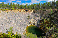 Sinkn hole in boreal forest<br /> Wood Buffalo National Park<br /> Northwest Territories<br /> Canada
