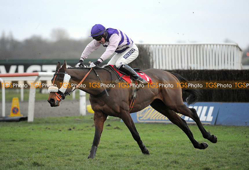 Whispering Jack ridden by Gavin Sheehan jumps the last and goes on to win the 32RedBet.com Handicap Chase Cl4 - Horse Racing at Kempton Park Racecourse, Sunbury, Middlesex -16/03/2013 - MANDATORY CREDIT: Martin Dalton/TGSPHOTO - Self billing applies where appropriate - 0845 094 6026 - contact@tgsphoto.co.uk - NO UNPAID USE.