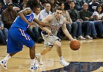 March 3, 2012:   Nevada Wolf Pack Keith Fuetsch drives against Louisiana Tech Bulldogs Kenneth Smith during their NCAA basketball game played at Lawlor Events Center on Saturday night in Reno, Nevada.