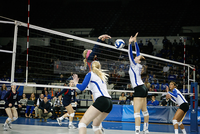 Sophomore Kayla Tronick (13) blocks a tip during the University of Kentucky women's volleyball game vs. Duquesne University at Memorial Coliseum  in Lexington, Ky., on Saturday, December 7, 2013. Kentucky defeated Duquesne 3-0. Photo by Adam Pennavaria | Staff