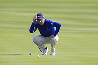Justin Rose (ENG) lines up his putt on the 8th green during Sunday's Final Round of the 2014 BMW Masters held at Lake Malaren, Shanghai, China. 2nd November 2014.<br /> Picture: Eoin Clarke www.golffile.ie
