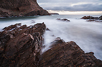 A long exposure allows waves to appear soft, white, and level, like a mist, over the angular rocks at Second Valley.