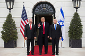 US President Donald J. Trump (R) waves beside Prime Minister of Israel Benjamin Netanyahu (L) and US Vice President Mike Pence while greeting Netanyahu at the South Portico of the White House in Washington, DC, USA, 25 March 2019. Trump later signed an order recognizing Golan Heights as Israeli territory.<br /> Credit: Michael Reynolds / Pool via CNP