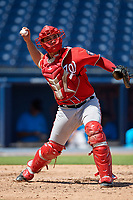 Washington Nationals catcher KJ Harrison (4) throws down to first base during an Instructional League game against the Miami Marlins on September 26, 2019 at FITTEAM Ballpark of The Palm Beaches in Palm Beach, Florida.  (Mike Janes/Four Seam Images)