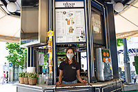 LISBON, PORTUGAL - MAY 18 :  The employee of an open cafe poses for a portrait while waiting for customers in Lisbon, on May 18, 2020. <br /> Restaurants, museums and coffee shops reopen at reduced capacity, while Lisbon eases lockdown coronavirus disease (COVID-19) outbreak.<br /> (Photo by Luis Boza/VIEWpress via Getty Images)