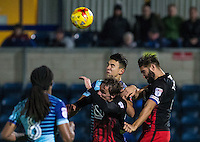 Luke O'Nien of Wycombe Wanderers goes up for the ball against Jordan Turnbull (right) of Coventry City & Callum Maycock of Coventry City during the The Checkatrade Trophy Southern Group D match between Wycombe Wanderers and Coventry City at Adams Park, High Wycombe, England on 9 November 2016. Photo by Andy Rowland.