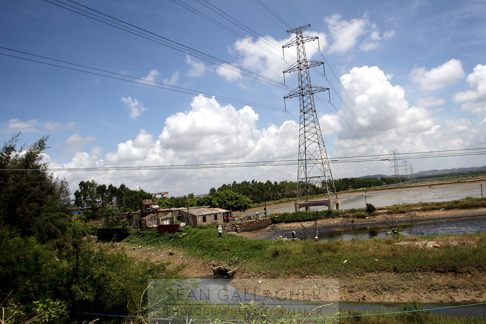 Shrimp ponds in the city of Zhanjiang, in Guangdong Province. Over the past century, the world has lost over 50% of its coastal mangroves. They have been cleared mainly to make way for commercial shrimp and fish farms. The unique trees which live in salt water are valued for the ability to protect shorelines and are home to a diverse array of flora and fauna. 2010