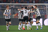 Calcio, Serie A: Roma vs Udinese. Roma, stadio Olimpico, 17 marzo 2014.<br /> Udinese midfielder Giampiero Pinzi, second from right, celebrates with teammates, from left, Dusan Basta, Antonio Di Natale, Allan Marques Loureiro, Emmanuel Badu and Widmer Silvan after scoring during the Italian Serie A football match between AS Roma and Udinese at Rome's Olympic stadium, 17 March 2014.<br /> UPDATE IMAGES PRESS/Isabella Bonotto