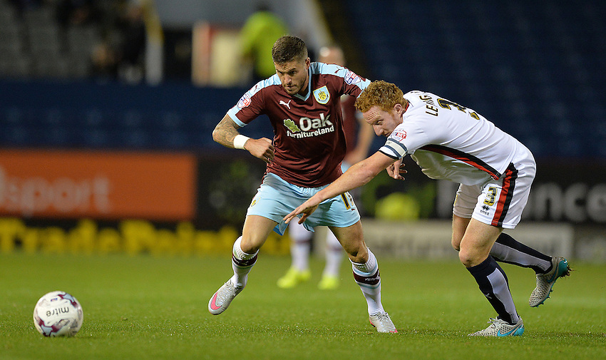 Burnley's Michael Kightly battles with MK Dons' Dean Lewington<br /> <br /> Photographer Dave Howarth/CameraSport<br /> <br /> Football - The Football League Sky Bet Championship - Burnley v Milton Keynes Dons - Tuesday 15th September 2015 - Turf Moor - Burnley<br /> <br /> &copy; CameraSport - 43 Linden Ave. Countesthorpe. Leicester. England. LE8 5PG - Tel: +44 (0) 116 277 4147 - admin@camerasport.com - www.camerasport.com