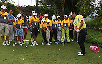 Danny Chia (MAS) gives a masterclass on chipping during the Junior Clinic ahead of the 2014 Maybank Malaysian Open at the Kuala Lumpur Golf & Country Club, Kuala Lumpur, Malaysia. Picture:  David Lloyd / www.golffile.ie