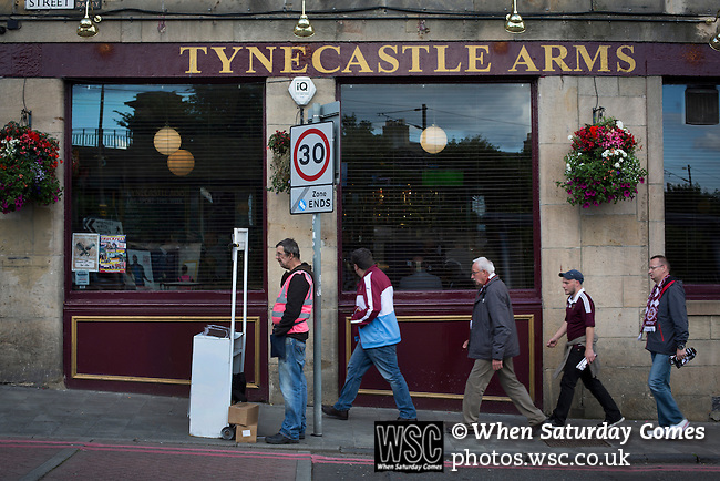 Heart of Midlothian 1 Birkirkara 2, 21/07/2016. Tynecastle Park, UEFA Europa League 2nd qualifying round. Home supporters walking past a pub outside Tynecastle Park, Edinburgh before Heart of Midlothian played Birkirkara of Malta in a UEFA Europa League 2nd qualifying round, second leg. The match ended in victory for the Maltese side by 2-1 and they progressed on aggregate after the first match had ended 0-0. The game was watched by 14301 spectators, including 56 visiting fans of Birkirkara. Photo by Colin McPherson.