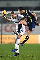Milan Skriniar of Internazionale and Riccardo Meggiorini of AC Chievo Verona compete for the ball during the Serie A 2018/2019 football match between Chievo Verona and Inter at stadio Bentegodi, Verona, December 22, 2018 <br />  Foto Daniele Buffa / Image Sport / Insidefoto