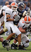 Florida International University Golden Panthers v. Bowling Green University Falcons at Miami, Florida on Saturday, September 16, 2006...Junior defensive lineman Roland Clarke (99).Bowling Green junior running back Dan Macon (5)