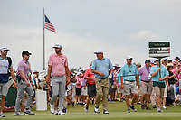 Dustin Johnson (USA) and Jason Dufner (USA) head down 1 during round 4 of The Players Championship, TPC Sawgrass, at Ponte Vedra, Florida, USA. 5/13/2018.<br /> Picture: Golffile | Ken Murray<br /> <br /> <br /> All photo usage must carry mandatory copyright credit (&copy; Golffile | Ken Murray)