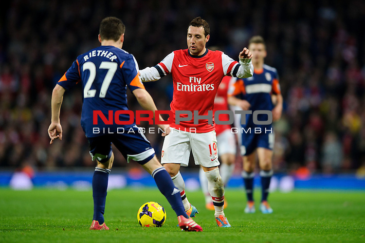 Arsenal Midfielder Santi Cazorla (ESP) is challenged by Fulham Defender Sascha Riether (GER) during the match -  - 18/01/14 - SPORT - FOOTBALL - Emirates Stadium - Arsenal v Fulham - Barclays Premier League.<br /> Foto nph / Meredith<br /> <br /> ***** OUT OF UK *****