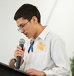 """Eighth grader Erik Lopez presents, """"Reader Today, Leader Tomorrow"""" during The Rusk School ribbon cutting ceremony, April 7, 2014."""