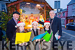 Caitlyn O'Sullivan, Shauna Riordan and Emily O'Donoghue with Fr. Dan at the Blessing of the crib at the Castleisland Christmas lights Event on Friday