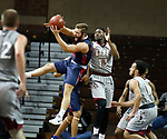 SIOUX FALLS, SD - MARCH 9:  Jake Feickert #12 of Oklahoma Wesleyan hauls in a loose ball in front of Aaron Thomas #13 of IU East at the 2018 NAIA DII Men's Basketball Championship at the Sanford Pentagon in Sioux Falls. (Photo by Dick Carlson/Inertia)
