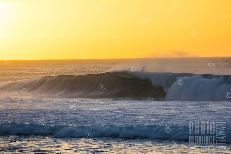 Evening glow on a breaking wave at Pipeline, North Shore, O'ahu.