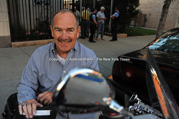 Tom Rowan, 65, a retired police detective and veteran of the 1968 Chicago Democratic National Convention Riots, gets on his bike outside Fraternal Order of Police Headquarters after leaving the 1968 Riot Cop Reunion in Chicago, Illinois on June 26, 2009.