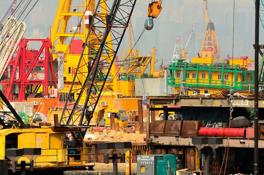 Mass of floating construction machinery as a new wharf is built into Victoria Harbor, Hong Kong