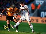 Enda Stevens of Sheffield Utd tackles Adama Traore of Wolverhampton Wanderersduring the Premier League match at Molineux, Wolverhampton. Picture date: 1st December 2019. Picture credit should read: Simon Bellis/Sportimage