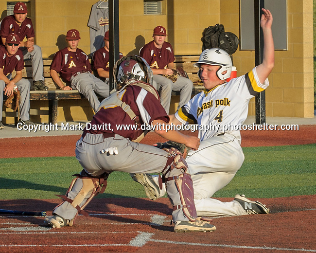 Southeast Polk and Ankeny met for a double header at SEP June 21. SEP prevailed twice, 2-0 and 8-1. SEP's Kacer Lukas gets tagged out at home.