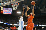 02 February 2013: Virginia Tech's Marshall Wood (33) shoots over North Carolina's Desmond Hubert (14). The University of North Carolina Tar Heels played the Virginia Tech Hokies at the Dean E. Smith Center in Chapel Hill, North Carolina in an NCAA Division I Men's college basketball game. UNC won the game 72-60 after overtime.