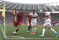 Calcio, Serie A: Roma, stadio Olimpico, 28 maggio 2017.<br /> AS Roma's Francesco Totti (l) in action with Genoa's Miguel Veloso (c) and Diego Laxalt (r) during the Italian Serie A football match between AS Roma and Genoa at Rome's Olympic stadium, May 28, 2017.<br /> Francesco Totti's final match with Roma after a 25-season career with his hometown club.<br /> UPDATE IMAGES PRESS/Isabella Bonotto