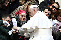 Papa Francesco saluta alcuni membri del Coro delle Mani Bianche di Lecce al terminedell'udienza generale del mercoledi' in Piazza San Pietro, Citta' del Vaticano, 20 marzo 2019.<br /> Pope Francis greets members of the White Hands Choir from Lecce in Italy at the end of the weekly general audience in St. Peter's Square at the Vatican, on March 20, 2019.<br /> UPDATE IMAGES PRESS/Isabella Bonotto<br /> <br /> STRICTLY ONLY FOR EDITORIAL USE