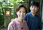 Mika and Hiromi Obata pose fro a photo outside their ryokan Chikuyo, which is located next to the Adachi Museum of Art in Yasugi, Shimane Prefecture, Japan. Chikuyo is one of the few ryokan in Japan to offer entirely micro-organic meals.. Photographer: Robert Gilhooly