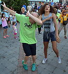 "Attenders seen practicing Flash Mob moves at the Third Annual Diversity Parade & the 7th Annual ""Let's Move! Ulster"" Program in Rondout Area of Kingston, NY, on Wednesday, June 21, 2017. Photo by Jim Peppler. Copyright/Jim Peppler-2017."
