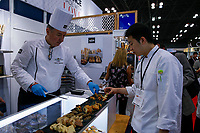 NEW YORK, NY - JUNE 23: A chef serves French pastry during the Summer Fancy Food Show at the Javits Center in the borough of Manhattan on June 23, 2019 in New York, The Summer Fancy Food Show is the largest and biggest specialty food industry event in the continent (Photo by Kena Betancur/VIEWpress/Corbis via Getty Image