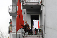 A woman on the balcony.