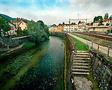 SWITZERLAND, Couvet,  L'arerse River running through the center of town, Jura Region