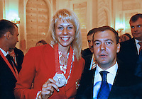 Krasnodar, Russia, 17/03/2009..Pick-up photo of world champion heptathlete Tatyana Chernova with Russian President Dmitri Medvedev. Chernova, who won bronze in the Beijing Olympic Games, is tipped for gold in London.