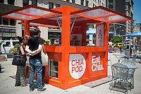 Workers at the Chia Co. promotional kiosk give away samples of their Bircher Muesli product in Madison Square in New York on Friday, July 11, 2014. (© Richard B. Levine)