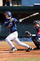 Craige Lyerly #16 of the Catawba Indians follows through on his swing versus the Shippensburg Red Raiders on February 14, 2010 in Salisbury, North Carolina.  Photo by Brian Westerholt / Four Seam Images