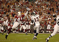Aug. 31, 2006; Glendale, AZ, USA; Arizona Cardinals safety (41) Jack Brewer breaks up a pass intended for Denver Broncos wide receiver (13) David Terrell at Cardinals Stadium in Glendale, AZ. Mandatory Credit: Mark J. Rebilas