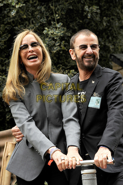 Barbara Bach & Ringo Starr .The Chelsea Flower Show 2012, London, England..May 21st, 2012.half length water pump married husband wife black beard facial hair sunglasses shades grey gray smiling married husband wife .CAP/CJ.©Chris Joseph/Capital Pictures.