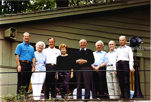 Camp David, Maryland - June 2, 1990 -- (Left to right):  James A. Baker, III, United States (U.S.) Secretary of State; U.S. first Lady Barbara Bush; U.S. President George H.W. Bush; Union of Soviet Socialist Republics (U.S.S.R.) first lady Raisa Gorbachev; U.S.S.R. President Mikhail Gorbachev; U.S.S.R. Foreign Minister Eduard Shevardnaze; U.S. National Security Advisor Brent Scowcroft; and U.S.S.R. Marshal Sergei Akhromeyev pose for a group photo during their visit to the presidential retreat Camp David, Maryland on June 2, 1990..Credit: White House via CNP