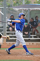 Ryan Cuneo of the Chicago Cubs participates in intrasquad spring training games at the Cubs complex on March 21, 2011  in Mesa, Arizona. .Photo by:  Bill Mitchell/Four Seam Images.