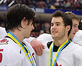 Kristopher Letang (Ste-Julie, QC - Foreurs de Val d'Or), Dan Bertram (Calgary, AB - Boston College Eagles), Darren Helm (St. Andrews, NB - Medicine Hat Tigers) - Team Canada celebrates with the gold medal trophy following Team Canada's 4-2 victory over Team Russia in the 2007 World Championship on Friday, January 5, 2007 at Ejendals Arena in Leksand, Sweden.