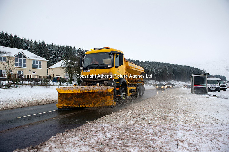 Pictured: A grittier drives in the snow at Libanus, in Brecon, Wales, UK. Friday 01 February 2019<br /> Re: Heavy snow and freezing temperatures affecting parts of the UK.